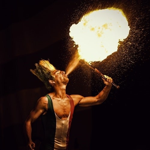 Fire breather demonstrating that your course should entertain